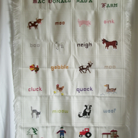 Shawl, blanket or wall-hanging entitled 'Old MacDonald had a farm'.