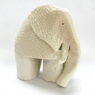 Porcelain elephant ornament with the texture of a lace doily.
