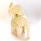 Porcelain Elephants - ornament with lace texture.