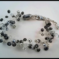 Dainty black and silver beaded bracelet, lightweight floating jewellery.