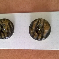 Set of  four brown two hole  vintage buttons