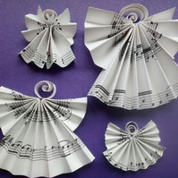 2 Handmade Angel Christmas decorations. Recycled from sheet music or book
