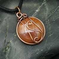 Copper Wire Wrapped Pendant with Circular Peach Orange Coloured Stone