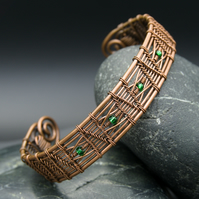 Woven zigzag copper cuff with green beads