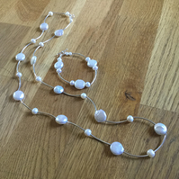 Long freshwater pearl and silver necklace with matching bracelet