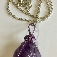 Amethyst Pendant encased in wire cage