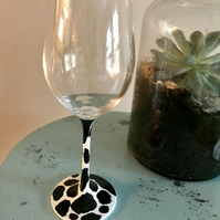 Wine glass with hand painted cow print
