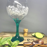 Gin glass with hand painted lace design and emerald base and stem