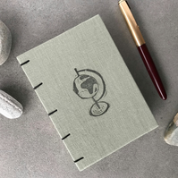Handbound A6 Coptic stitch notebook, with original linocut globe design