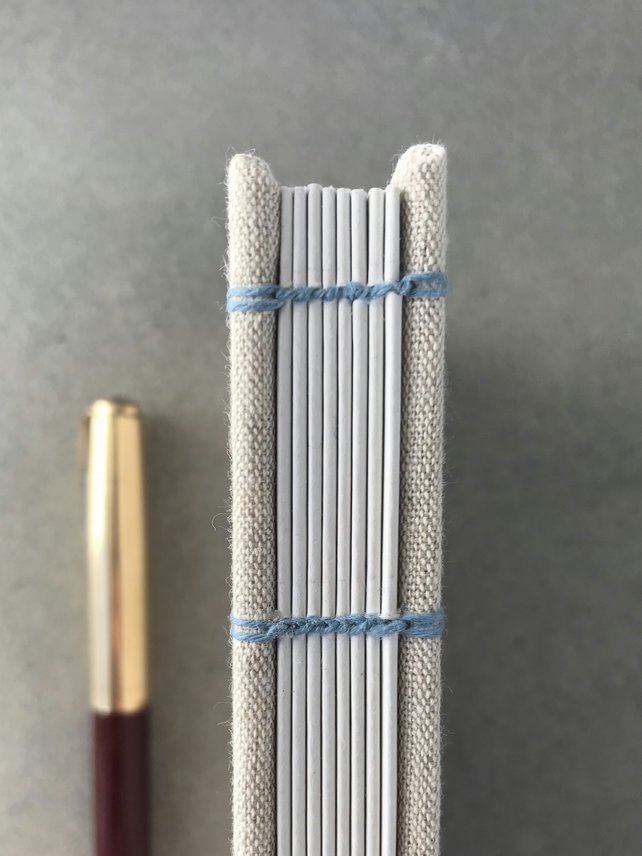 Handbound A6 coptic stitch lined notebook, cloth cover
