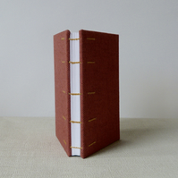 A6 Coptic stitch blank notebook, red cloth cover