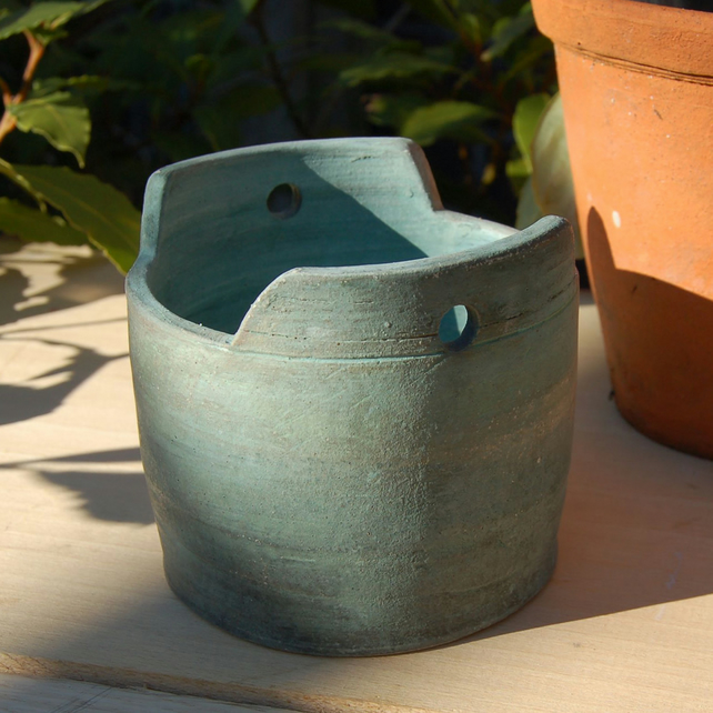 Green ceramic planter with rustic finish
