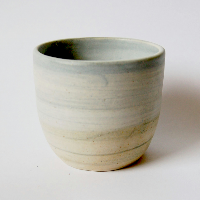 Pale blue ceramic tumbler. Handmade pottery cup. Blue ceramic tumbler