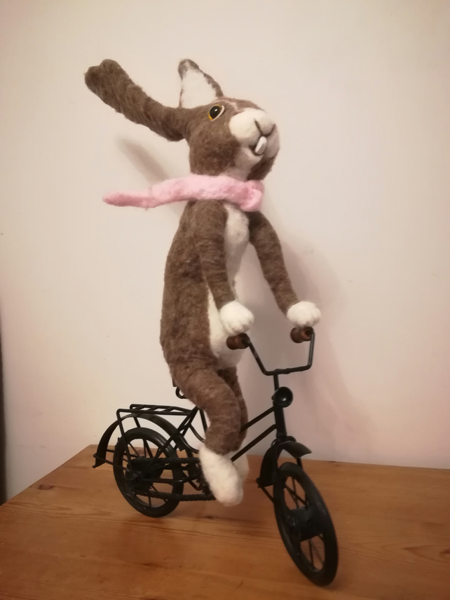 SOLD Hare needle felted wool sculpture riding bicycle hairy biker