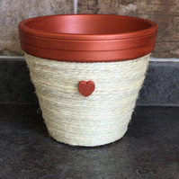 Terracotta plant pot in copper and cream with matching saucer.