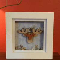 Box frame with wooden moose silhouette.