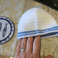 White Crocheted Baby Hat with Blue Stripes