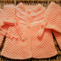 pale orange newborn baby traditional handknitted lace outfit