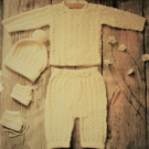 Baby boys handknitted cream outfit of jacket, short trousers, pom pom hat, boots