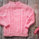 Pink hand knitted jumper, aran style with cables for baby girl toddler, merino