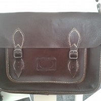 repaired old leather satchel