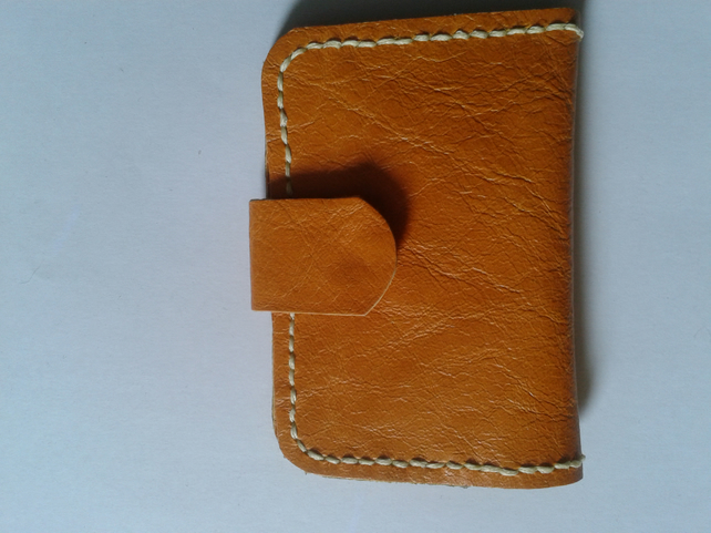 orange leather sewing needle case