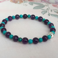 Turquoise & Amethyst Elastic Gemstone Bracelet with a cut Sterling Silver Bead.