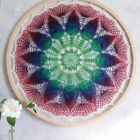 Hummingbird Fran, a vintage doily pattern hoop in bright pinks, blues and greens