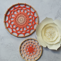 Peach crochet mandalas in two sizes
