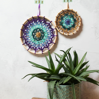 Pair of peacock coloured mandalas