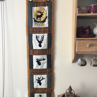 Handmade embroidered and quilted stag wall hanging