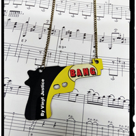 Comic strip gun necklace made from a record. A 45 from an old 45