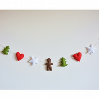 Christmas felt garland, white star, red heart, gingerbread man and green tree.