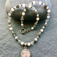 Rose Quartz sterling silver pendant with rose quartz and faceted quartz beads