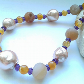 Gold Electroplated Freshwater Pearls and Amethyst colour theory necklace.