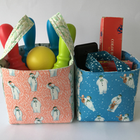 Two nesting fabric storage baskets