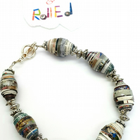 Bracelet made of blue and multicolored paper beads