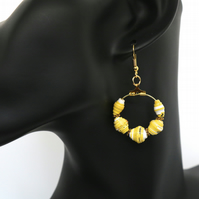 Hoop earrings with small yellow paper beads
