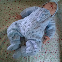 Beautiful hand knitted baby romper in baby blue with beanie hat, socks and shoes