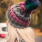 Multicolored cap with pom pom