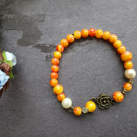 Orange Beaded Stretchy Stackable Bracelet with Flower Charm