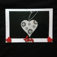 Photo of a love heart with hand painted wooden details.