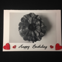 Black & white poppy photo with hand painted wooden hearts.
