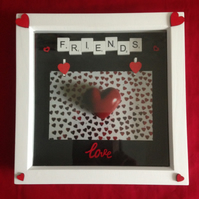 Friends photo frame, with white wooden scrabble letters & wooden details.