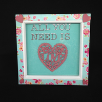 All you need is love 3D picture with wooden hearts.