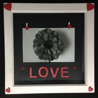 Photo frame with hand painted wooden letters saying love & wooden hearts.