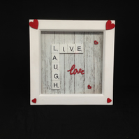 Live, Laugh, Love scrabble picture with hand painted wooden hearts.
