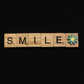 Smile scrabble magnet with hand painted wooden flower.