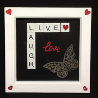 Live,Laugh,Love scrabble picture. With a silver butterfly & wooden hearts.