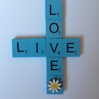 "Pale blue scrabble magnet saying ""Live"" & ""Love"""